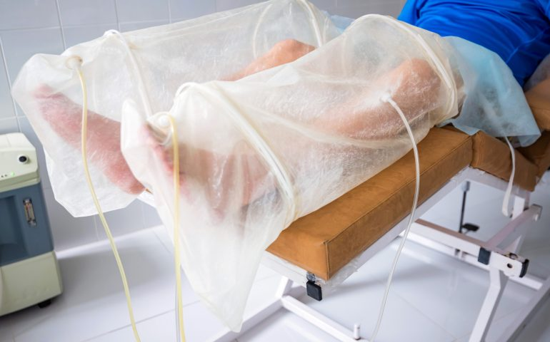 Ozone therapy treatment on legs of man